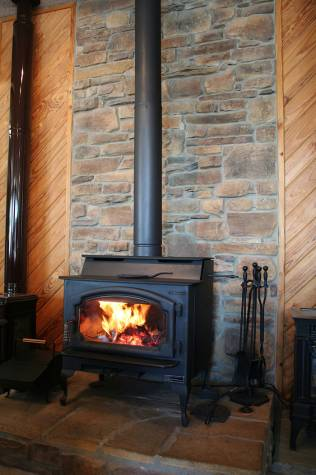 The Lopi Liberty wood burning stove heats our showroom! Buy now, 2008
